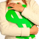 image - hugging a green paper dollar