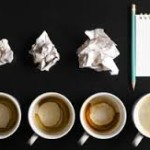 image - success from failure - coffee cups and crumpled paper